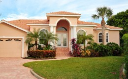Upscale house with luxurious tropical landscaping